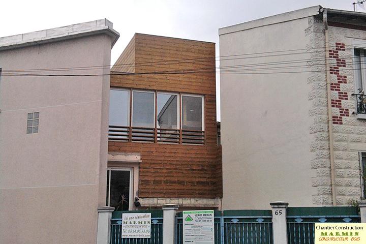 Constructeur maisons bois extension par sur l vation de maison construction maison passive for Construction bois 93